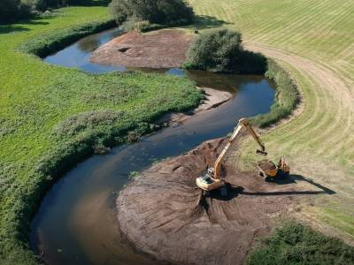 The idea of the River Restoration scheme is to enhance the quality of the river, by improving the shape through reprofiling the banks and introducing gravel riffles, to create improved water flow along the course of the river.