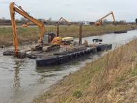Workign for the Parrett Internal Drainage Board, the contract is for 2.2km of maintenance dredging upstream of Northmoor pumping station and has been funded by the Somerset Rivers Authority (SRA). Long reach machines have been dredging mainly from the bank with the final section using an excavator on a floating pontoon to load barges, towed by a tugboat to be offloaded upstream.  The works follow on from previous dredging on the Parrett and Tone Rivers in 2014 which was identified as producing the biggest flood reduction risk on the Somerset Levels and Moors.